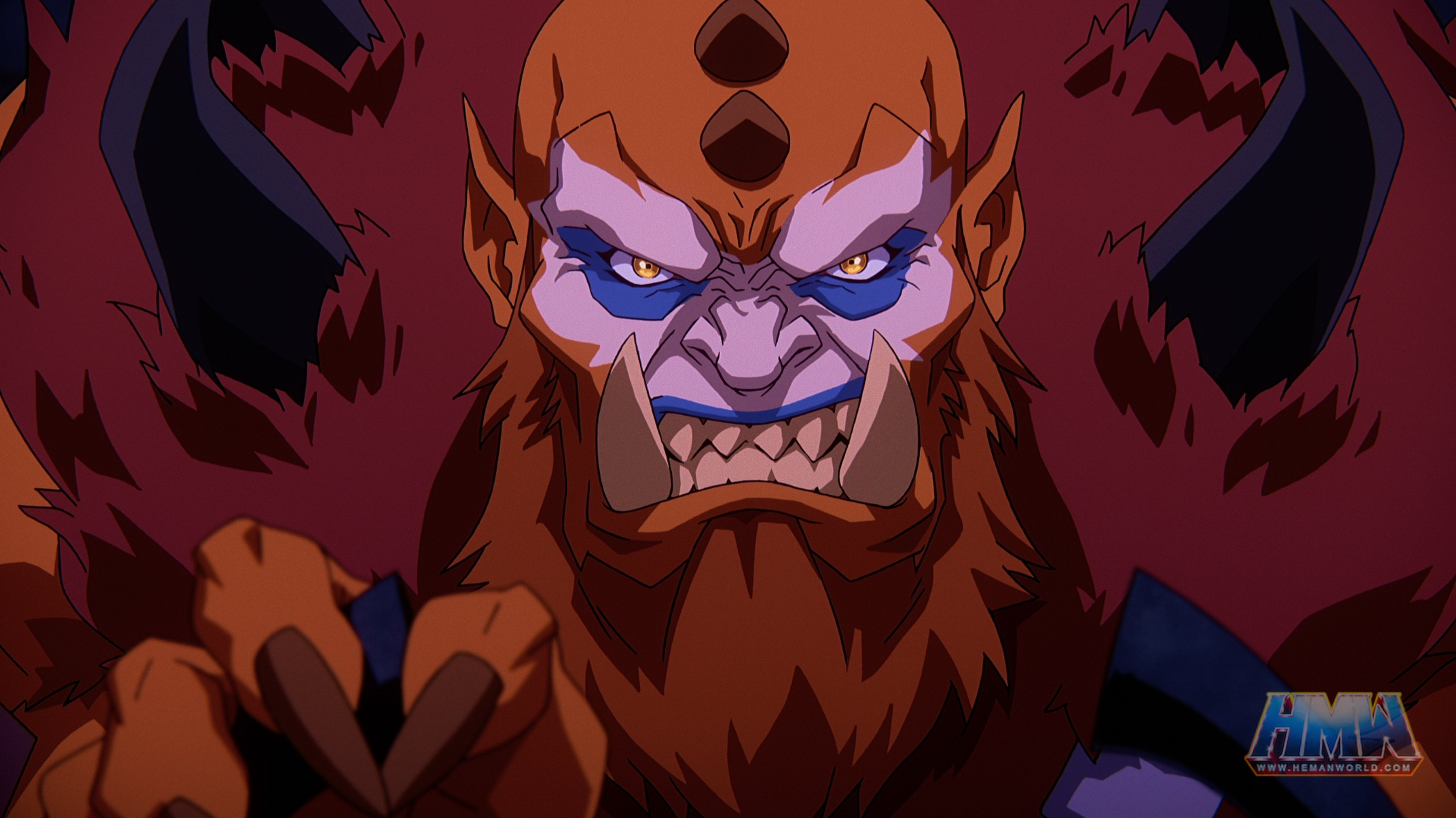In a CG animated close-up still from Masters of the Universe: Revelation, Beast Man, a large male figure with pointed ears, maroon fur, a long red beard, pink and blue face paint and horns on his head and back. He looks straight ahead and bares his teeth in a growl.